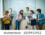 group of kids with laptop and... | Shutterstock . vector #1025911912