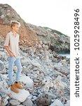 young man on rocky beach... | Shutterstock . vector #1025928496