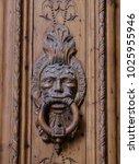 ornate knocker on old wood door | Shutterstock . vector #1025955946