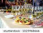 line of glasses with champagne... | Shutterstock . vector #1025968666