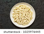 traditional italian penne pasta ... | Shutterstock . vector #1025976445