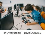 concentrated teen child... | Shutterstock . vector #1026000382