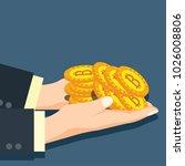 hand holding golden bitcoins... | Shutterstock .eps vector #1026008806