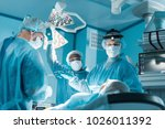 multicultural surgeons and... | Shutterstock . vector #1026011392