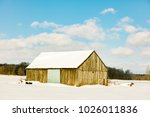 antique barn in rural quebec... | Shutterstock . vector #1026011836