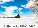 antique barn in rural quebec... | Shutterstock . vector #1026011842