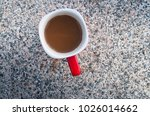 coffee in red cup on table rock | Shutterstock . vector #1026014662