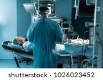 back view of surgeon operating... | Shutterstock . vector #1026023452