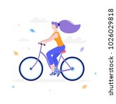 slim girl riding a bicycle in... | Shutterstock .eps vector #1026029818