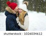 couple in love in winter scenery | Shutterstock . vector #1026034612