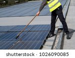 fitting photovoltaic panels on... | Shutterstock . vector #1026090085