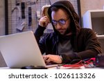 man in hoodie using laptop on... | Shutterstock . vector #1026113326