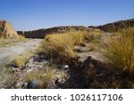 small river bed running through ... | Shutterstock . vector #1026117106