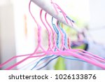 colorful clothes hangers | Shutterstock . vector #1026133876