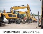multiple cars  excavators ... | Shutterstock . vector #1026141718