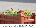 wooden flowerbed in the square | Shutterstock . vector #1026151066