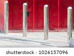 steel bollards on concrete... | Shutterstock . vector #1026157096