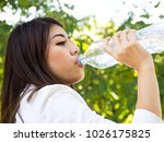 young asian woman drinking... | Shutterstock . vector #1026175825