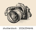 modern camera in doodle style.... | Shutterstock .eps vector #1026204646