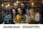 in the bar  restaurant hispanic ... | Shutterstock . vector #1026207592