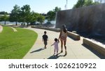 woman and children walking in... | Shutterstock . vector #1026210922