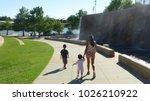 woman and children walking in... | Shutterstock . vector #1026210922