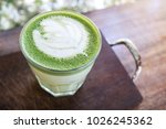 glass of hot japanese matcha... | Shutterstock . vector #1026245362