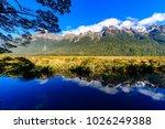 Mirror Lake Milford Sound National Park New Zealand - stock photo