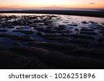 the sun rises over the atlantic ... | Shutterstock . vector #1026251896