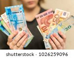 Small photo of Russian roubles and some new 200 and 2000 roubles bills.