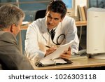 an image of medical consultation | Shutterstock . vector #1026303118