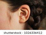 girls ear closeup   Shutterstock . vector #1026336412