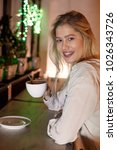young woman drinking tea in... | Shutterstock . vector #1026343726