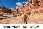 backpacker hiker man treks... | Shutterstock . vector #1026408325