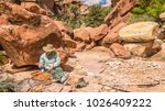 backpacker hiker man rests... | Shutterstock . vector #1026409222