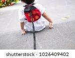 little boy toddler is sitting... | Shutterstock . vector #1026409402