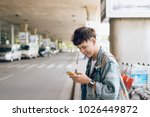 young asian passenger waiting... | Shutterstock . vector #1026449872