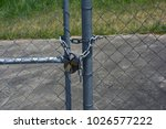 Small photo of Taringa, Brisbane, Australia - February 2018: Gates with padlocks and chains