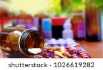 Small photo of Tablets and capsules are packed in bottles, Adherence to treatment of side effects, the danger of using drugs to buy drugs themselves. Without consulting with the pharmacist.