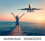 airplane and woman at sunset.... | Shutterstock . vector #1026632242