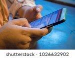 closeup of smartphone user   Shutterstock . vector #1026632902