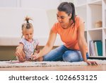 mother and daughter in their... | Shutterstock . vector #1026653125