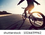 cyclist riding bike on the... | Shutterstock . vector #1026659962