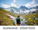pretty traveling woman standing ... | Shutterstock . vector #1026672232