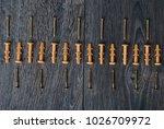 dowels lying in rhythm on dark... | Shutterstock . vector #1026709972