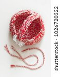 Small photo of Martenitsa, crochet basket, white and red strains of yarn, Bulgarian folklore tradition, welcoming the spring in March, adornment symbol, wish for good health. Baba Marta Day. UNESCO list heritage.