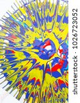 Small photo of abstract expressionism, design, art concept. in the round form there is imprint on the white sheet of paper, it is drawn by artist with shining acrylic paints of bright colores