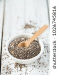 Small photo of chia seeds in a bowl on wooden surface