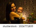 smiling young mother holding... | Shutterstock . vector #1026771835