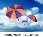 umbrella's falling from a blue... | Shutterstock . vector #102684356